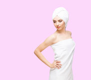 Young, beautiful and natural woman wrapped in towel  on Stock Photos