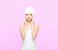 Young, beautiful and natural woman wrapped in towel  on Stock Images