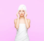 Young, beautiful and natural woman wrapped in towel  on Royalty Free Stock Photography