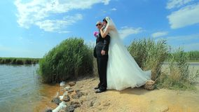 Young Beautiful Newlyweds Embracing And Kissing stock video footage