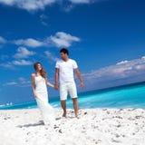 Young  beautiful newlyweds on white sandy beach Stock Photography
