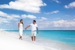 Young  beautiful newlyweds on white sandy beach Royalty Free Stock Photos