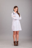 Young and beautiful nurse on a grey Stock Image