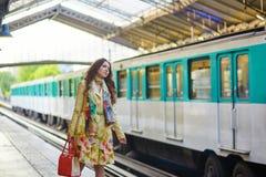 Young beautiful Parisian woman in subway Royalty Free Stock Photo