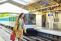 Young beautiful Parisian woman in subway Royalty Free Stock Photography