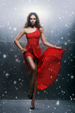 Young, beautiful and passionate woman in a wavy, long, red dress Stock Photos