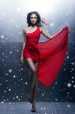 Young, beautiful and passionate woman in a wavy, long, red dress Royalty Free Stock Image