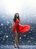 Young, beautiful and passionate woman in a wavy, long, red dress Royalty Free Stock Photos