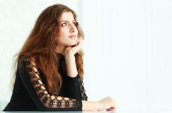 Young beautiful pensive woman looking at copyspace Stock Photography