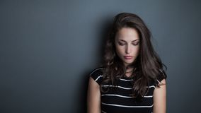 Young beautiful pensive woman portrait studio royalty free stock photography