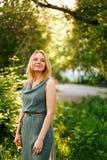 Young Beautiful Pensive Woman Smiling Stock Image