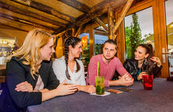 Young beautiful people with cocktails in bar or club Stock Photos