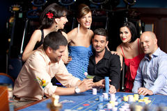 Young beautiful people having fun at the casino Royalty Free Stock Photos