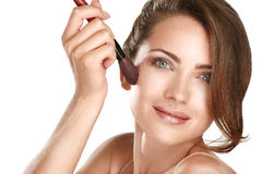 Young beautiful perfect model applying professional makeup Royalty Free Stock Images