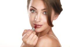 Young beautiful perfect model applying professional makeup Royalty Free Stock Photos