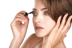 Young beautiful perfect model applying professional makeup Stock Images