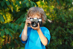 Young beautiful photographer shoots you Royalty Free Stock Images