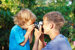Young beautiful photographers with camera outdoors Royalty Free Stock Image