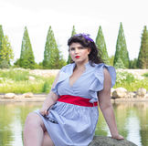 Young beautiful plus size model in dress near the lake Stock Photo