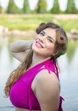 Young beautiful plus size model near the lake. Young beautiful plus size model, xxl woman portrait near the lake Stock Images