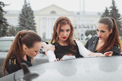 Young beautiful police woman stops car for checking driver license Stock Photo