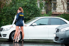 Young beautiful police woman stops car for checking driver. Young beautiful police women stops car for checking driver license Stock Photos