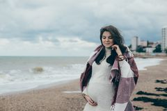 Young beautiful pragnant woman posing near sea at the beach Stock Images