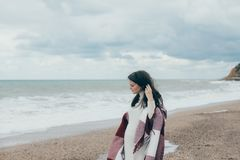Young beautiful pragnant woman posing near sea at the beach Royalty Free Stock Photography