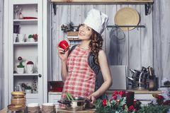 Young beautiful pregnant with at home in the kitchen smiling. Happy Stock Photo