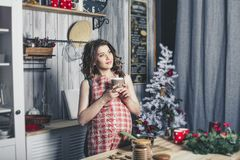 Young beautiful pregnant with at home in the kitchen smiling. Happy Stock Image