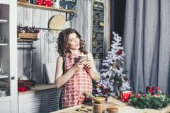 Young beautiful pregnant with at home in the kitchen smiling. Happy Stock Photography