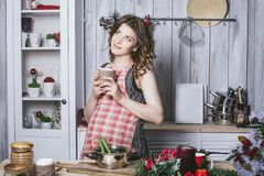 Young beautiful pregnant with at home in the kitchen smiling. Happy Stock Photos