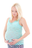 Young beautiful pregnant woman in blue isolated on white Royalty Free Stock Photo