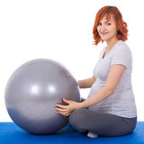 Young beautiful pregnant woman doing exercises with fitball isol. Ated on white background Stock Photos
