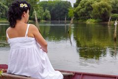 Young pregnant woman enjoying in nature near lake royalty free stock photography