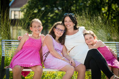 Young beautiful pregnant woman with her daughters. Happy family. royalty free stock images