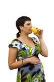 Young beautiful pregnant woman. With orange juice on a white background Stock Photo