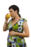 Young beautiful pregnant woman. With orange juice on a white background Royalty Free Stock Photo