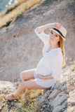 Young beautiful pregnant woman posing on a mountain near sea Royalty Free Stock Photo