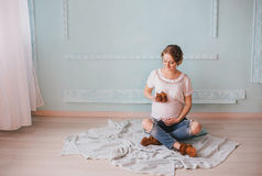 Young beautiful pregnant woman posing in a vintage interior Stock Image