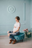 Young beautiful pregnant woman posing in a vintage interior Royalty Free Stock Photo