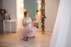 Young beautiful pregnant woman posing in a vintage interior Royalty Free Stock Image