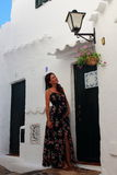 Young beautiful pregnant woman relaxing herself in the wonderful white walled streets of a mediterranean village in Menorca Island Royalty Free Stock Images
