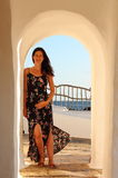 Young beautiful pregnant woman relaxing herself in the wonderful white walled streets of a mediterranean village in Menorca Island Royalty Free Stock Image