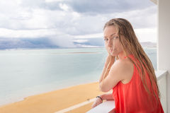 Young beautiful pretty  blondie woman standing balcony sea view. Young beautiful  blondie woman  standing balcony window above sea beach view,  Ein Bokek, Dead Stock Images