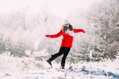 Young Beautiful Pretty Caucasian Girl Woman In Blue Sunglasses Dressed In Red Jacket And White Hat Smiling And Jumping Stock Photo