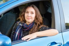 Young beautiful pretty girl sitting inside credit car. businesswoman driver. automobile trade royalty free stock images