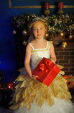 Young beautiful princess in white gold smart dress Royalty Free Stock Images