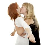 Young beautiful red and blond haired girls Stock Photos