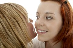 Young beautiful red and blond haired girls Royalty Free Stock Image
